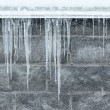 Winter icicles hanging from eaves of roof — Stock Photo #58400029