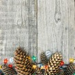 Christmas decoration with pine cones and lights — Stock Photo #59722327