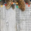 Christmas decoration with lights and pine cones — Stok fotoğraf #59722433