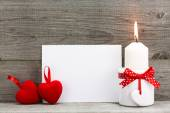 Valentines greeting card with two red hearts and candle — Stock Photo