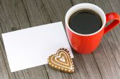 Cup of coffee and heart shape cookie  — Stock Photo