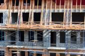 Building under construction with scaffolding — Stock Photo