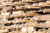 Old wooden sleepers in stacks — Stock Photo