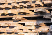Stack of wooden railway sleepers — Stock Photo