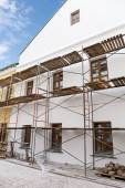 Facade of renovation building with scaffolding — Stock Photo