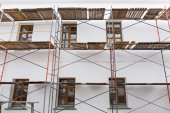 Scaffolding for building reconstruction — Stock Photo