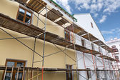 Scaffolding covering a building under restoration — Stock Photo