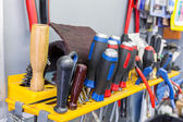 Screwdrivers hanging on tool panel — Stock Photo