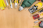 Working tools on wood background — Stock fotografie