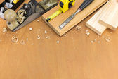 Carpenter tools with wood planks — ストック写真