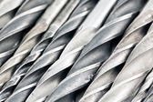 Used drill bits background — Stock Photo