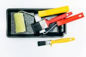 Paint rollers and brushes with tray — Stock Photo