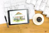 Architect's workspace with tablet and blueprints — Stockfoto