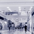 Shoppers at shopping center, motion blur. — Stock Photo #65424661