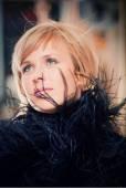 Fashionable attractive woman in flutter boa — Stock Photo