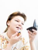 Woman doing a make-up — Stock Photo