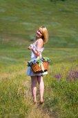 Sexy girl walk away with basket — Stok fotoğraf