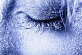 Frozen woman's eye covered in frost — Stock Photo