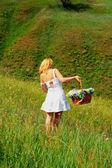 Sexy girl walk away with basket — Stock Photo