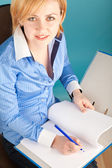 Businesswoman with pencil checks the documents in a folder — Stock Photo
