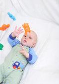 Bambino, giocando con giocattoli — Foto Stock