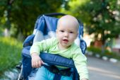Baby in sitting stroller — Stock Photo