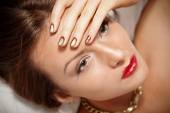 Portrait of attractive girl with beautiful spiral Minx nails — Stock Photo