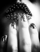 Close-up BW photo of metallic lips and Minx nails — Stock Photo