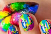 Woman's lips with beautiful multicolor Minx nails and make-up — Stock Photo
