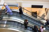 Peoples on escalators in a mall. Motion blur — Stock Photo