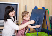 Prepare to school series. Mother teaching her daughter — Stock Photo