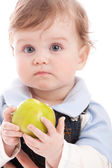 Portrait of adorable blue-eyes baby hold green apple — Stock Photo