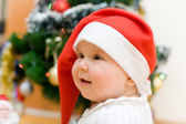 Little girl in red Santa hat — Stock Photo