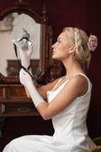 Portrait of beautiful woman holding venetian carnival mask — Foto Stock
