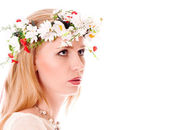Pretty spring girl with wreath on head looking forward — Stock Photo