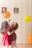Portrait of two little girls playing with airy balls — Stock Photo