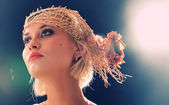 Portrait of beautiful retro-style woman in bonnet — Stock Photo