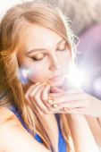 Portrait of attractive blond girl with golden minx manicure — Stock Photo
