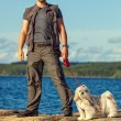 Young man tourist with dog — Stock Photo #61823505