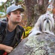 Young man tourist with dog — Stock Photo #61823551