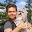 Young man tourist with dog — Stock Photo #61823577