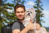 Young man tourist with dog — Stock Photo