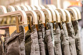 Preview jeans hanging on a hanger in the store — Stock Photo