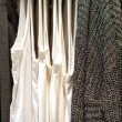 T-shirts and sweaters on a hanger in the store — Stock Photo #52097093