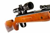 Air rifle with a telescopic sight and a wooden butt — Stock Photo