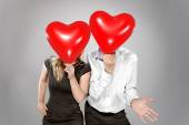 Couple with balloons instead of a head — Stock Photo