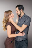 Embracing couple in love posing at studio — Stock Photo