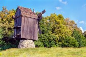 Ukrainian wooden windmill windmill stands near a forest in the f — Stock Photo