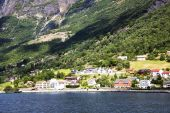 The shore of the fjord and Norwegian city — Stock Photo