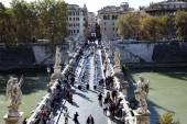 Festive procession of priests on a Saint Angelo Bridge — Stock Photo